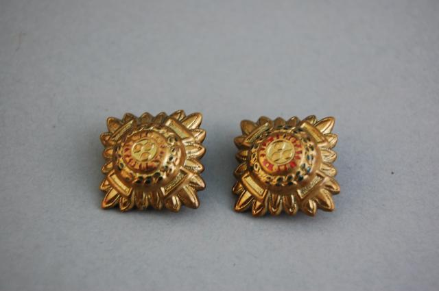 Officers 'pips'. A number of these worn on the shoulder of the uniform showed an officers rank.