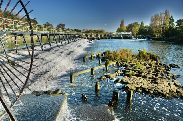 The weir at Teddington marks the division between the Upper Thames (non-tidal) and the Tideway (tidal Thames).  It is one of the largest weirs on the Thames