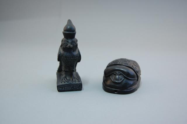 Replica statuettes of Horus as a hawk and a scarab beetle