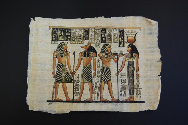 A replica decorated papyrus showing Anubis, Isis, and two Pharaohs