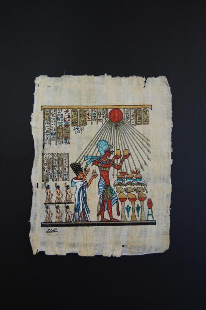 A replica decorated papyrus showing the pharaoh Akhenaten and his queen Nefetiti