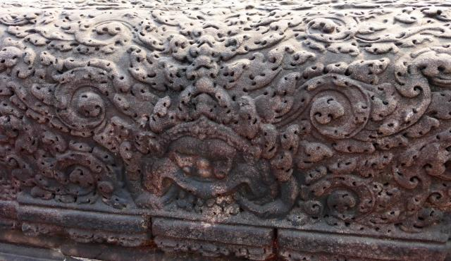 Carved sandstone balustrade at Angkor Wat temple