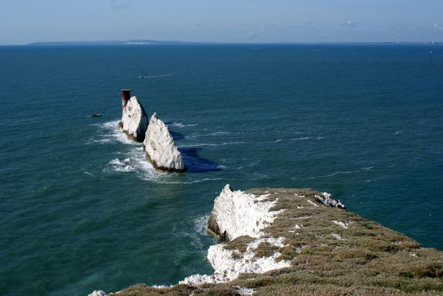 The Needles is the name given to stacks of chalk that rise out of the sea at the western point of the Isle of Wight off the south coast of England. The lighthouse is called The Needles Lighthouse and was built in 1859.