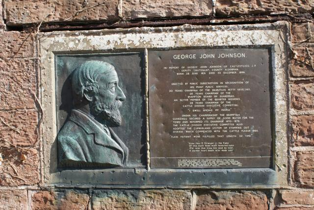 This plaque to George John Johnson (1816 - 96) is in community of Brampton, Cumbria, two miles south of Hadrian's Wall.  It commemorates his work in reforming a quality water supply to the area and also in achieving methods to stamp out Cattle Plague in 1866.