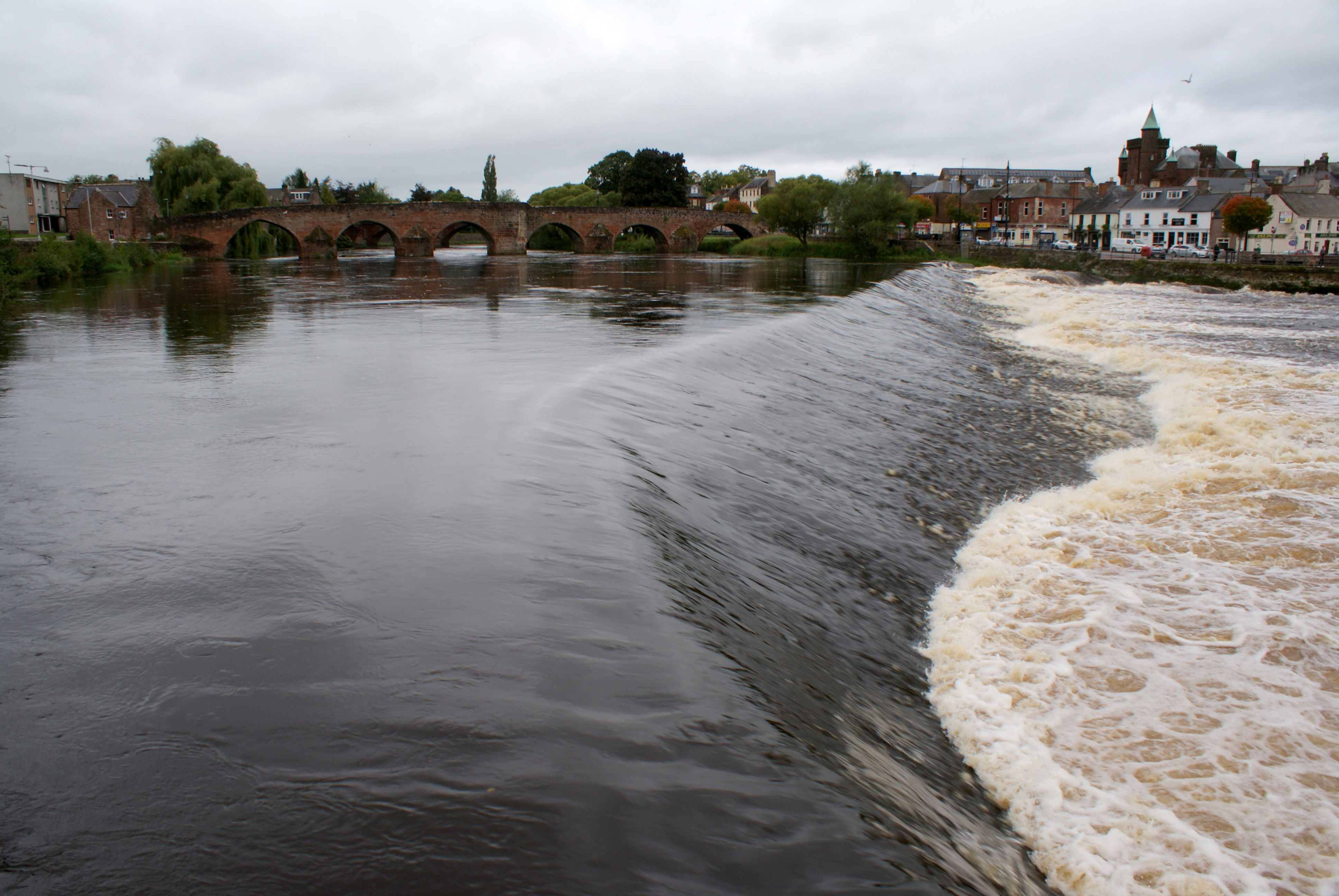 The weir on the River Nith at Dumfries. The weir is known locally as 'The Caul'. Dumfries is the traditional county town of the historic county of Dumfriesshire.
